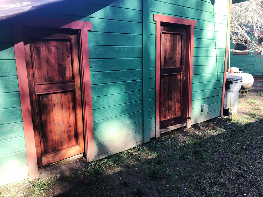 ​​Custom shed doors made of reclaimed redwood